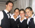 Four happy catering servers