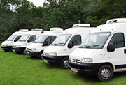 Five catering vans lined up in a row
